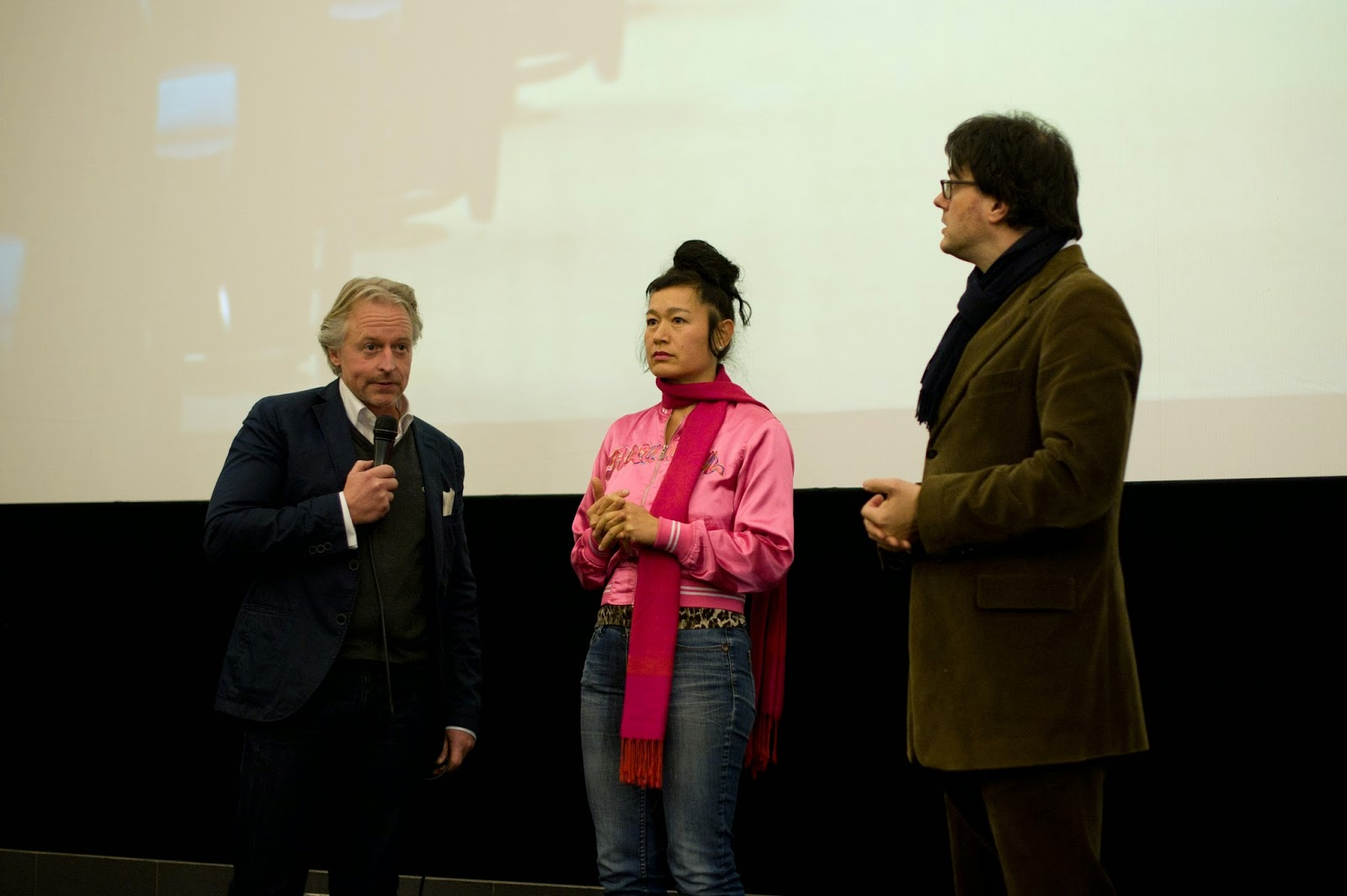 on stage: Olaf Stüber, Hito Steyerl, Ivo Wessel